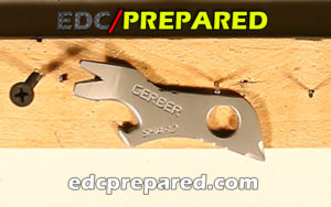 Gerber Shard EDC tool on a board with screws and nails