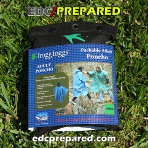 Frogg Toggs Poncho in pouch on the grass.
